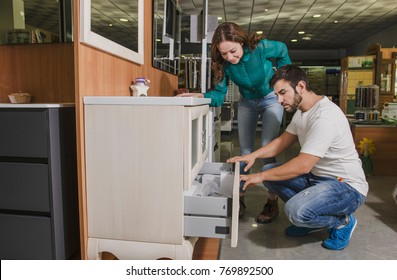 Couple in bath and furnitures store choosing and looking for his home indoors decoration after marriage