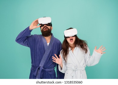 Couple in bathrobes wear vr glasses. Conscious awakening. Return to reality. Man and woman explore vr. VR technology and future. VR communication. Exciting impressions. Awakening from virtual reality.
