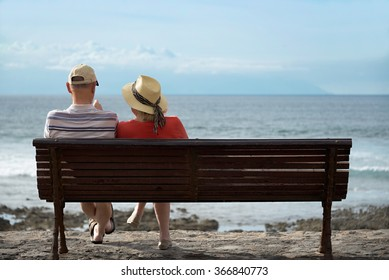 Couple at the beach.Elderly couple looking to the sea