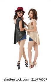 Couple of beautiful young asian woman full body posing in light and dark satin dress with blue shorts on white background.