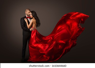 Couple Beauty Portrait, Beautiful Woman Dancing in Red Dress and Elegant Man, Cloth Fluttering on wind