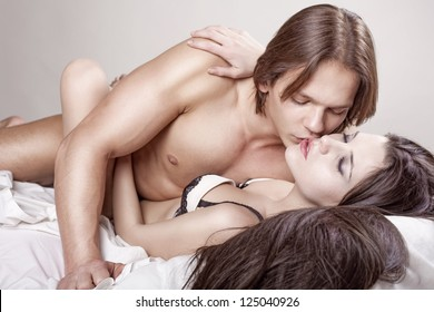 Couple beauty sexy lovers in bed on white background