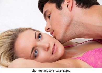 couple in bed during sex and affection. love and eroticism in the bedroom.