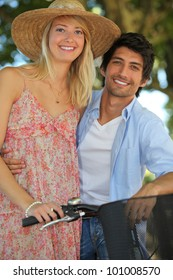 Couple with bike by springtime