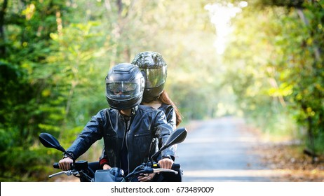 couple biker riding motorcycle