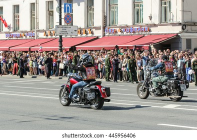 "A couple of bikers on motorcycles. St. Petersburg, Russia - 9 May, 2016. Holiday-action ""Immortal regiment"" taking place in St. Petersburg on Nevsky Prospect."