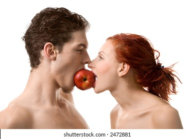 Couple biting an apple, isolated on white