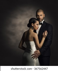 Couple in Black Suit and White Dress, Rich Man and Fashion Woman