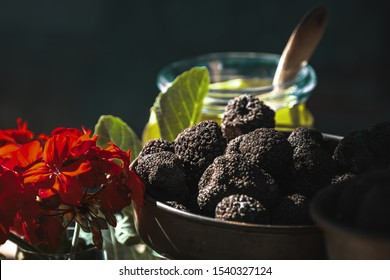 A couple of black truffles in the garden setting