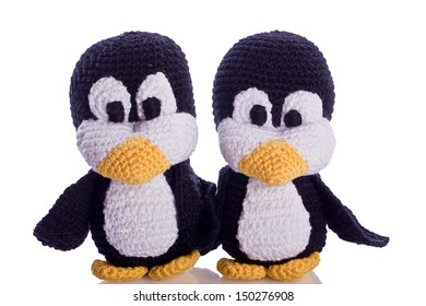 couple of black and white penguin stuffed animal