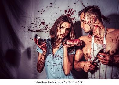 couple in blood. human internal organ trade. cannibalism. donation and donar. meatman in butcher shop, butchery. zombie. medical transplantation. bloody halloween. anatomy. Fresh tasty beef