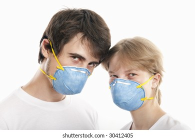 Couple  in blue face masks  with heads together  against white background