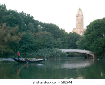 Couple in boat on water with bridge