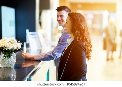 Couple booking a hotel room, concept