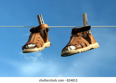 Couple of Boots Hanging on a Rope