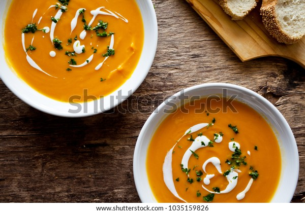 Couple of bowls of homemade soup with organic vegetables