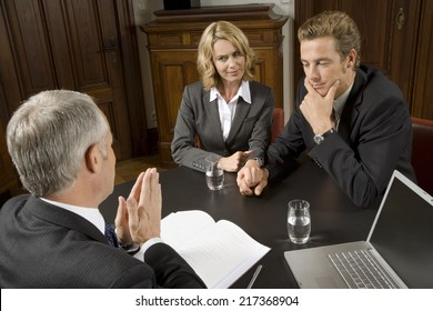 Couple in business meeting