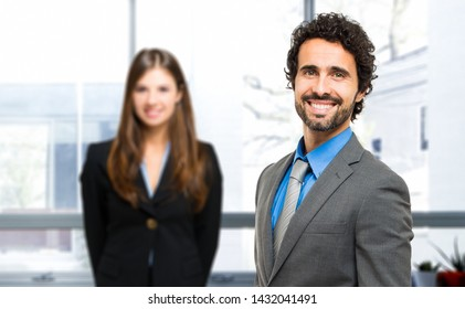 Couple of business people in a bright office