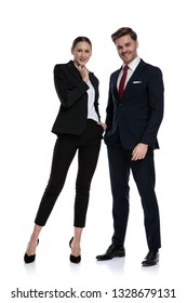 couple in business suits holding hands at chin thinking on white background