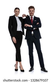 couple in business suits standing with arms crossed and elbow lean on shoulder on white background