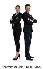 couple in business suits standing back to back with crossed arms on white background