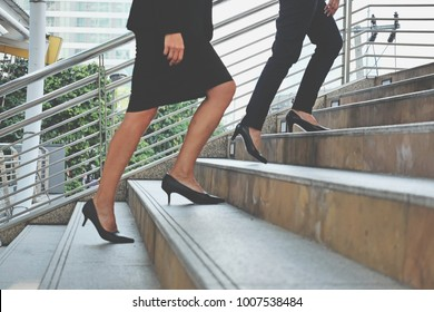 Couple of businesswoman going up the stairs in big city, young businesswoman walking up the stairs outside office, Business Lifestyle in modern city Concept