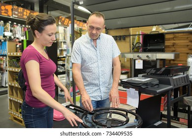 couple buyig barbecue