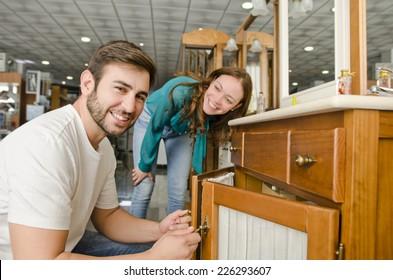 Couple buying furniture at big plumbing store
