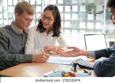 couple buying renting house car signing mortgage insurance purchase order contract with realtor real estate agent. architect designer closing dealing with customer