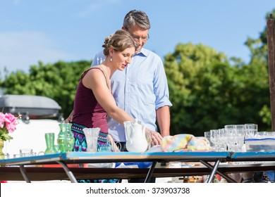 Couple buying stuff at flea market