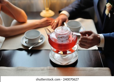 Couple in a cafe drinking tea