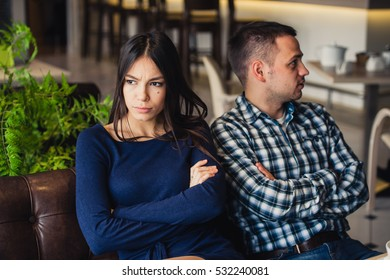 Couple at cafe during lunch. They are taking offense and sitting back