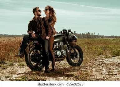 Couple and cafe racer motorcycle