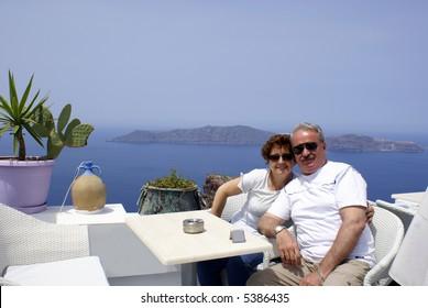 Couple at cafeteria on Santorini island, Greece