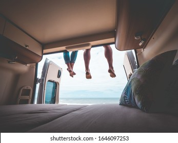 couple in a camper van on the beach