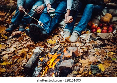 couple camping in the autumn forest. Fall background
