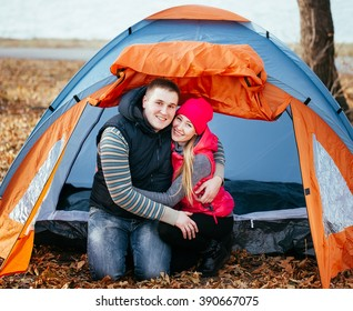 Couple camping. Young couple sitting near the tent.