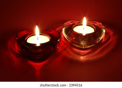 A couple candles for Valentine's Day, weddings, or other events involving love