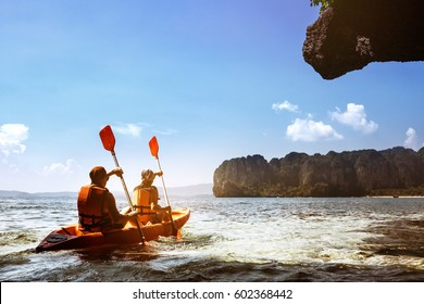 Couple canoeing or kayaking at sea island backdrop. Krabi province, Thailand. Space for text