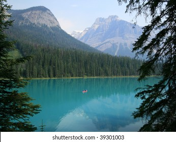 A couple canoeing on Emerald Lake in Yoho National Park, British Columbia, Canada.