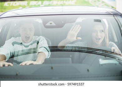 Couple in a car about to have a crash. Woman driver