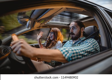 Couple in a car at sunset, with man driving fast and girl scared, screaming and crying.