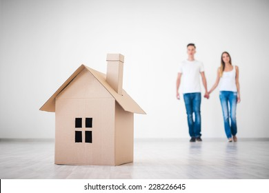 Couple with cardboard house