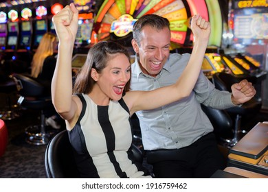 a couple celebrating casino victory
