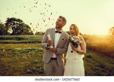 couple celebrating wedding day outdoors