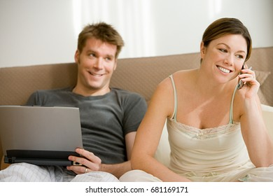 Couple with cellphone and laptop