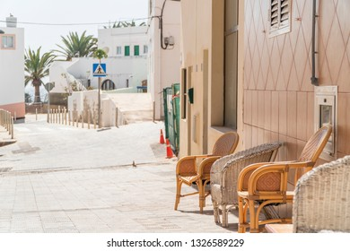 Couple of chairs by house on the street of Morro Jable, Fuerteventura