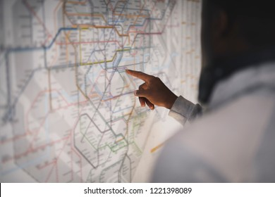 Couple checking a public transportation map