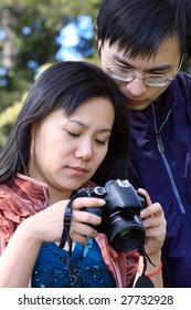 couple checking their photograph