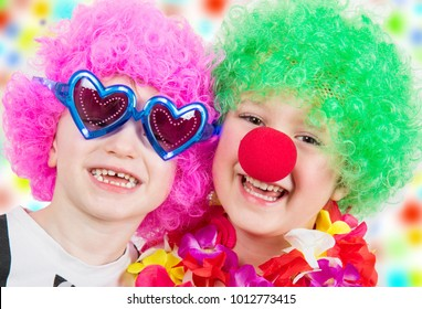 couple of child wearing clown objects for carnival